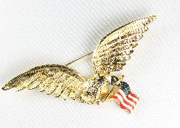 goldtone eagle in flight with flag